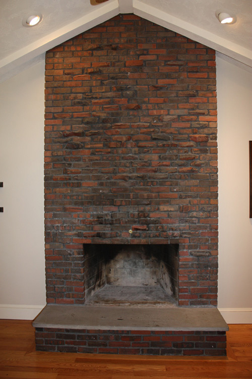 Before brick fireplace