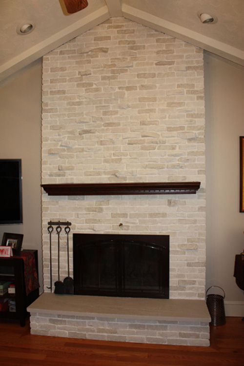 This brick fireplace desperately needed a makeover. The floor to ceiling brick fireplace was dark